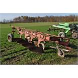 """IH 720 4-bottom plow, toggle trip, semi mount, 18"""" spring-loaded coulters"""