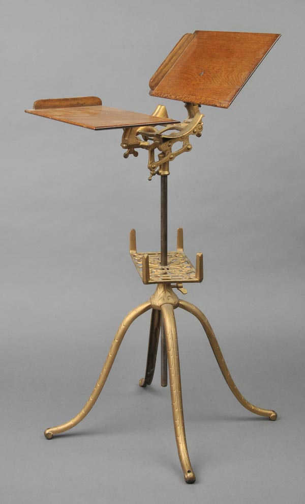 Lot 550 - Book stand. A late 19th-century American encyclopaedia stand,  with an elaborate cast iron base