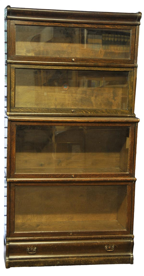 Lot 552 - Bookcase. A 1920s Globe Wernicke four tier oak bookcase,  with printed manufacturer's label and