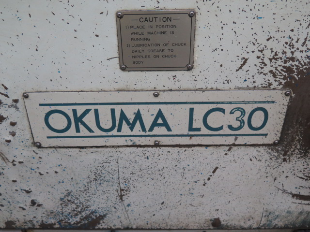 "Lot 95 - Okuma LC-30 CNC Turning Center s/n 55020135 w/ Okuma Controls, 12-Station Turret, 10"" 3-Jaw Power"