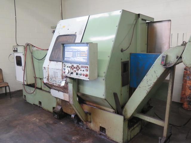 Lot 94 - Okuma LC-40 CNC Turning Center s/n 55020155 w/ Okuma Controls, 12-Station Turret, Chip Conveyor,