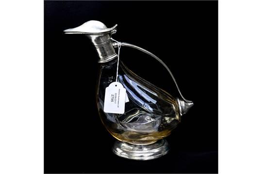 A Peltro duck shaped claret jug, hand made