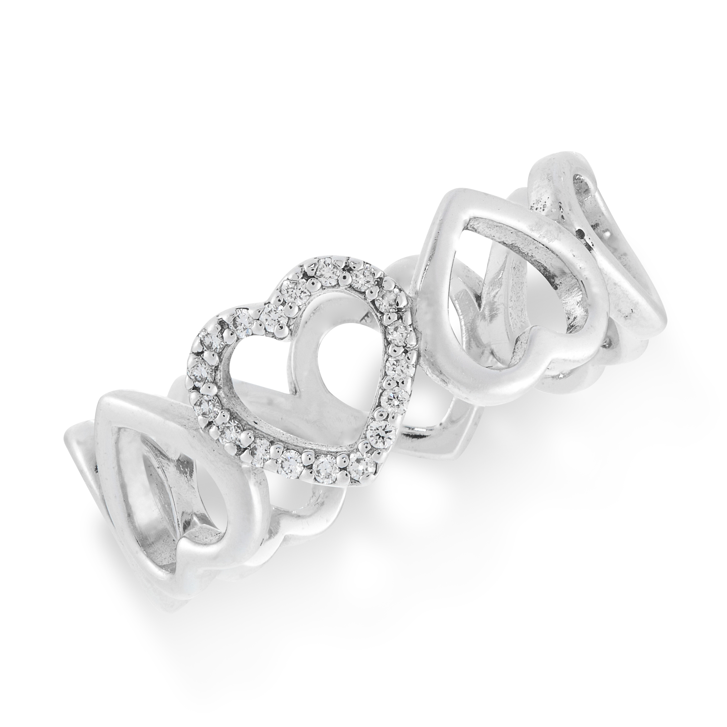 A DIAMOND HEART RING, TIFFANY & CO in 18ct white gold, the band formed of a row of eight hearts, one
