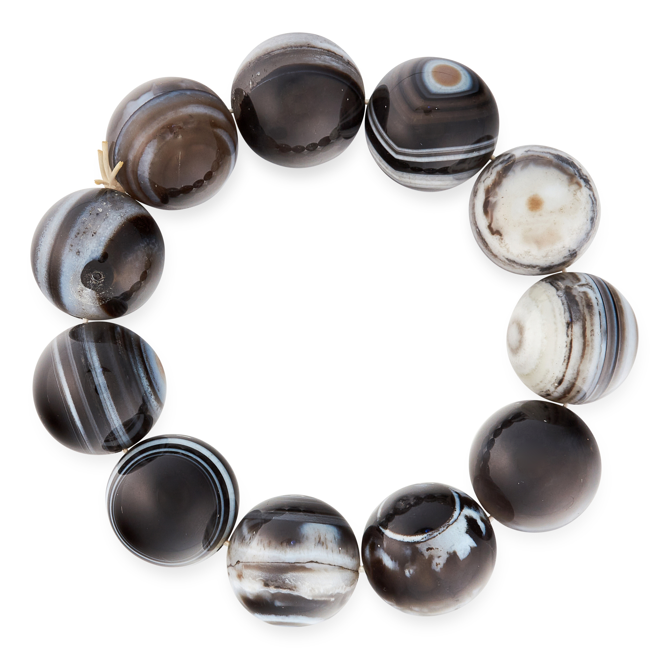 A BANDED AGATE BEAD BRACELET comprising of eleven beads 19.5mm in diameter, elasticated, 112.7g.