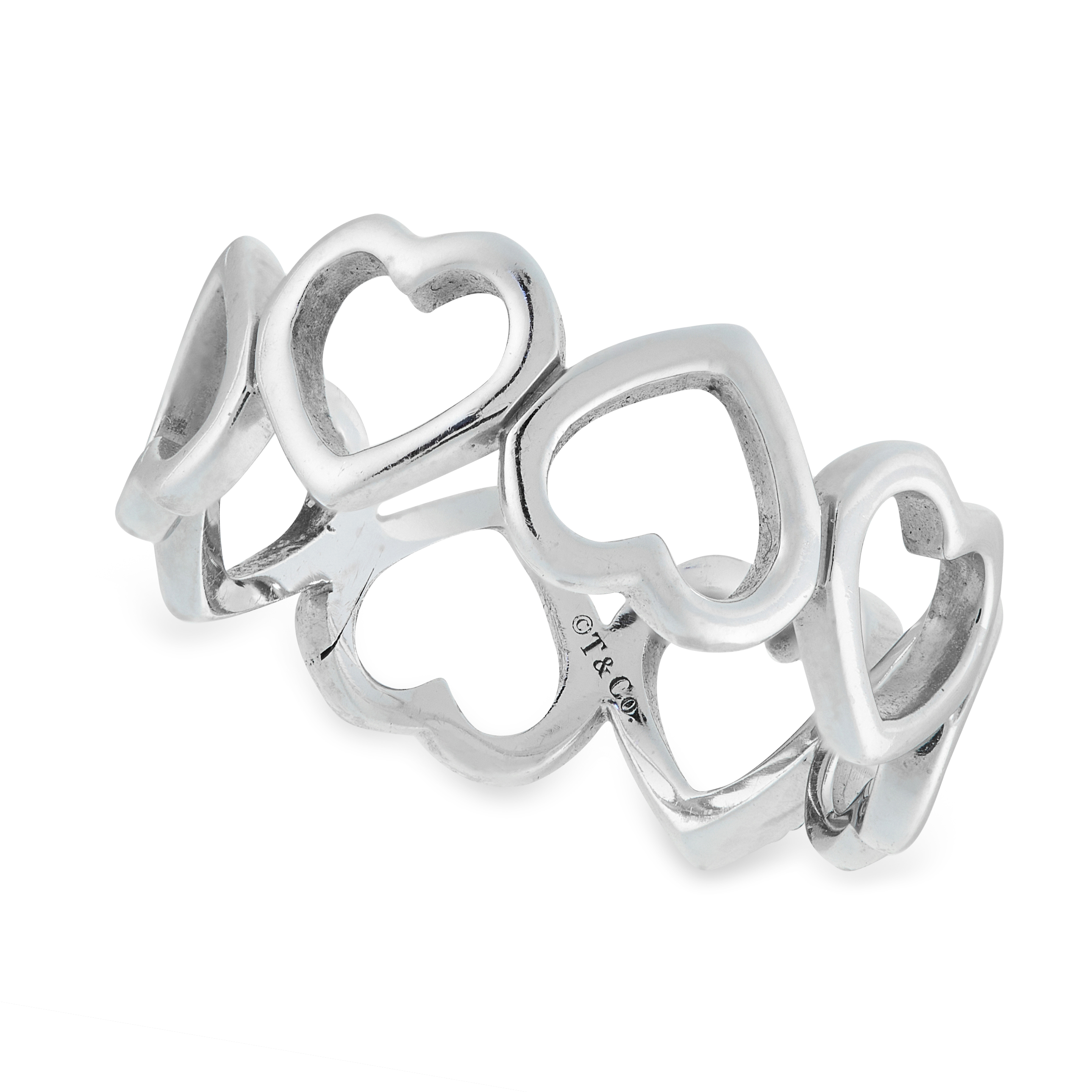 A DIAMOND HEART RING, TIFFANY & CO in 18ct white gold, the band formed of a row of eight hearts, one - Image 2 of 2