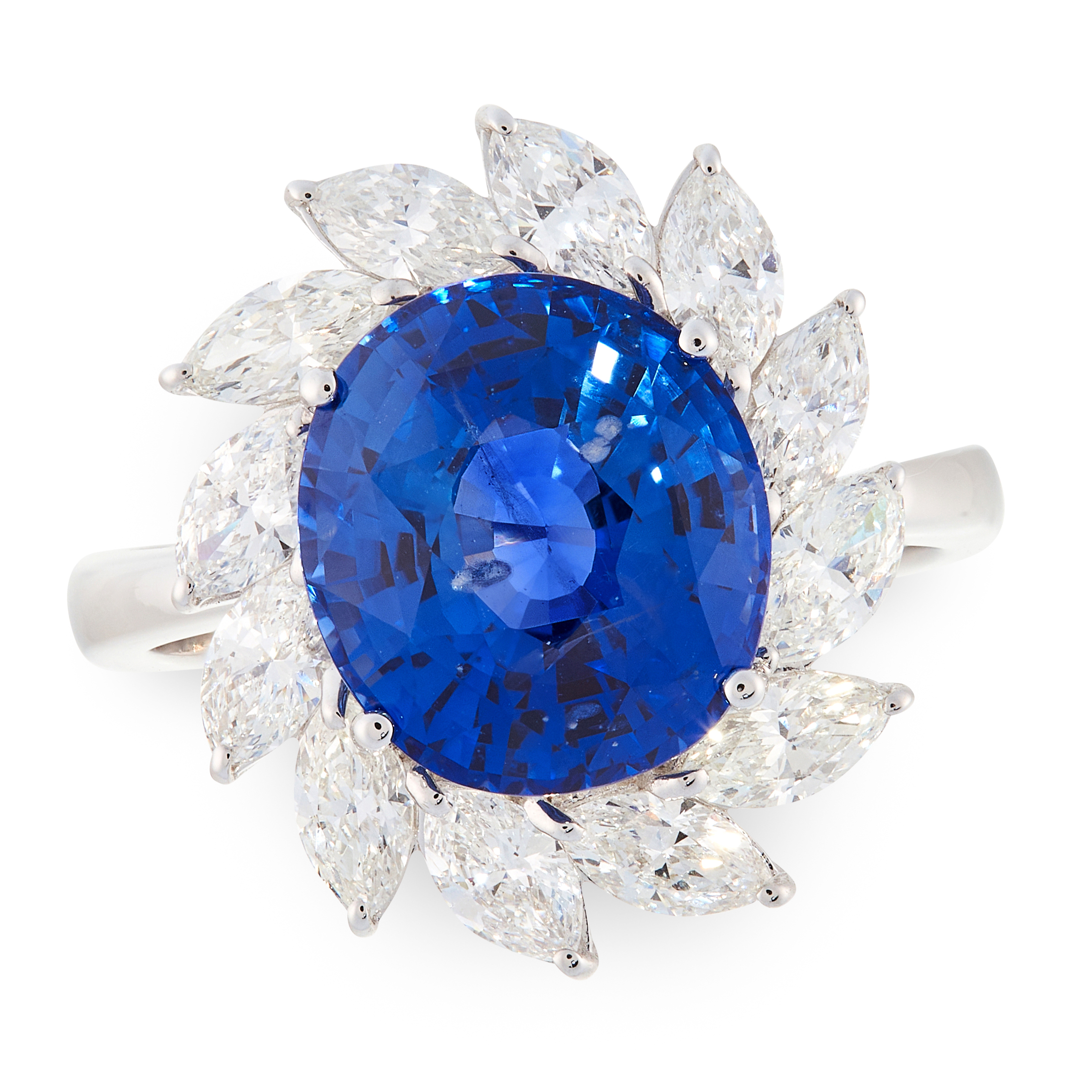 A SAPPHIRE AND DIAMOND CLUSTER RING in 18ct white gold, set with an oval cut sapphire of 6.77 carats