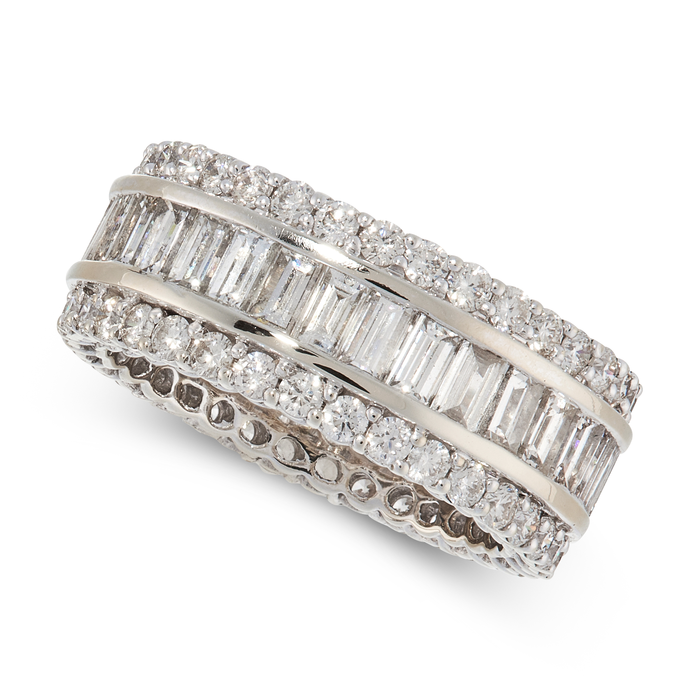 A DIAMOND ETERNITY RING in 18ct white gold, set with a central row of baguette cut diamonds
