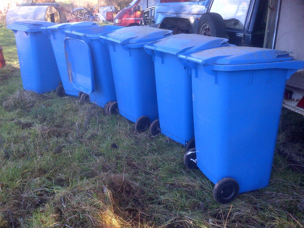 Lot 9 - 6 Clean blue wheelie bins, used for waste paper Stored near Langley, Norwich.