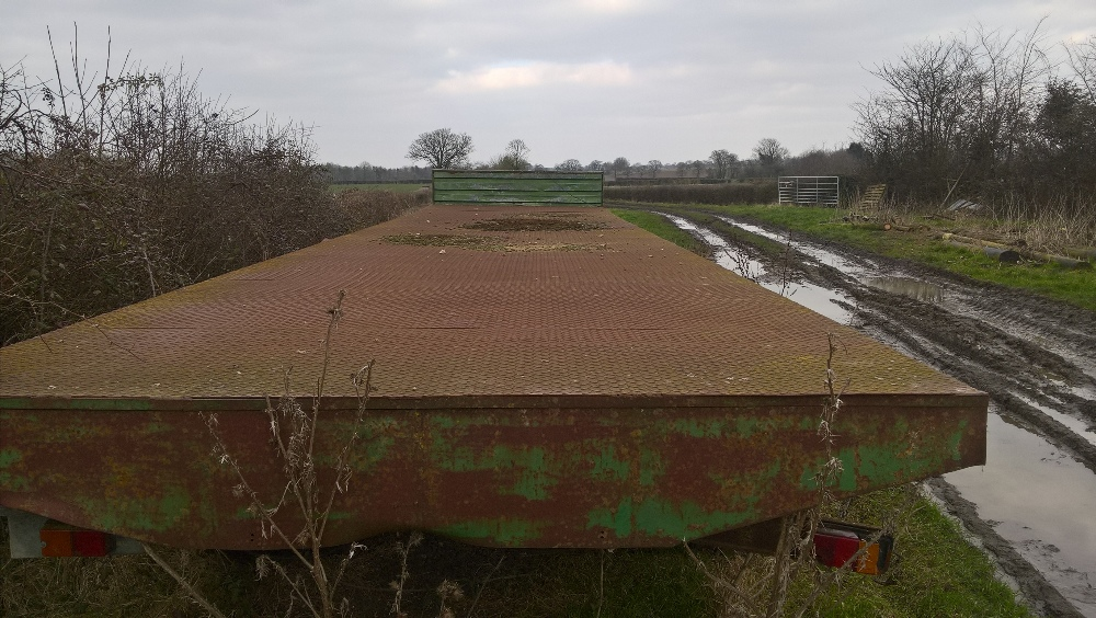 Lot 35 - 36 ft flat bed trailer steel decks and headboard Stored near Topcroft,