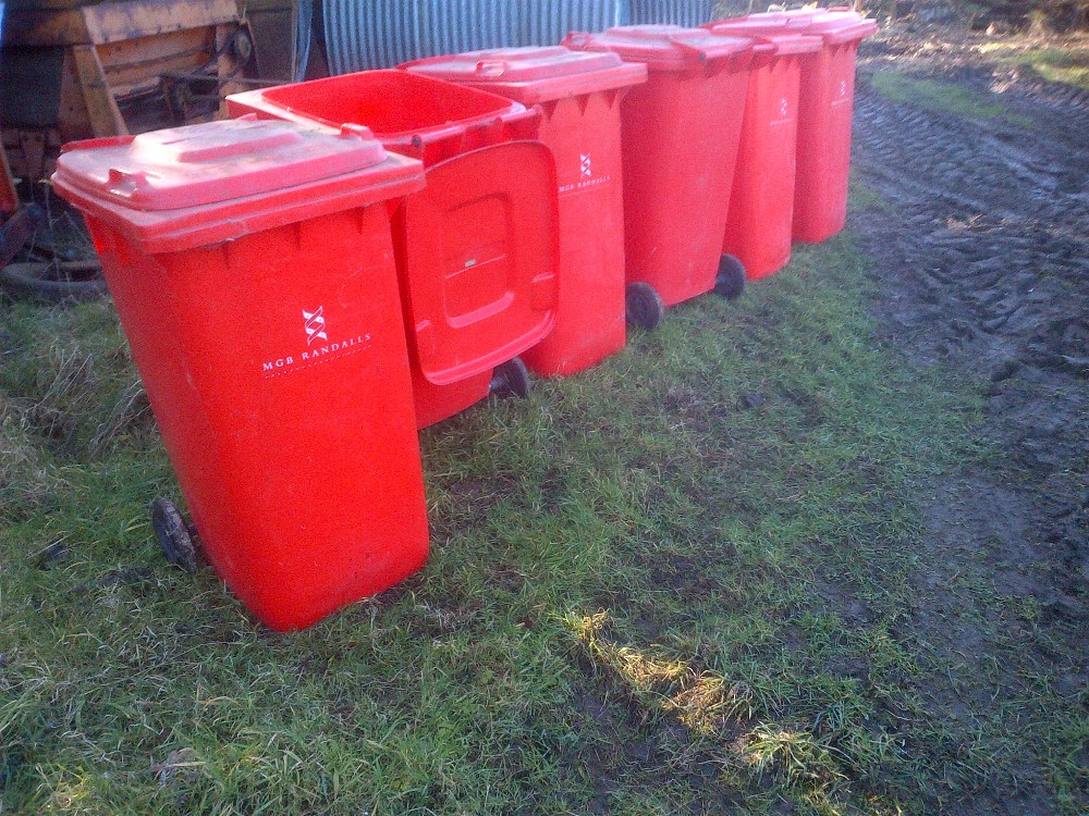 Lot 8 - 6 Clean red wheelie bins, used for waste paper Stored near Langley,
