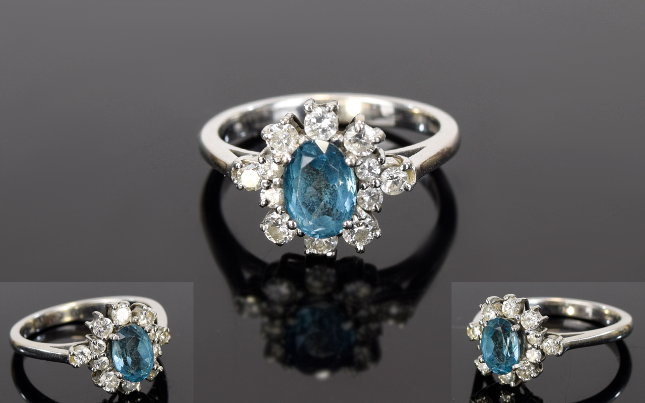 Lot 33 - 18ct White Gold Set Blue Topaz and Diamond Cluster Ring.