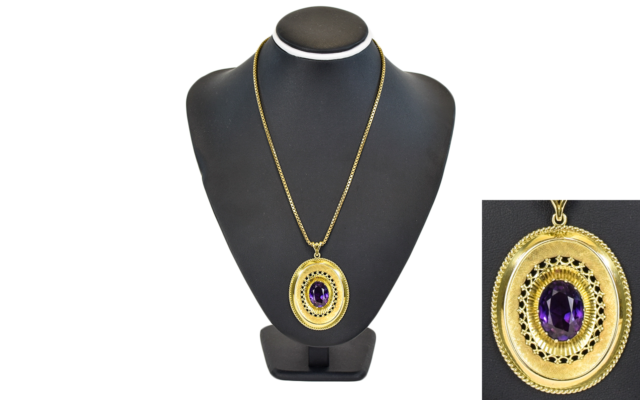 Lot 21 - A Fine 9ct Gold Oval Shaped Pendant Set with a Large Faceted Amethyst of Excellent Colour,