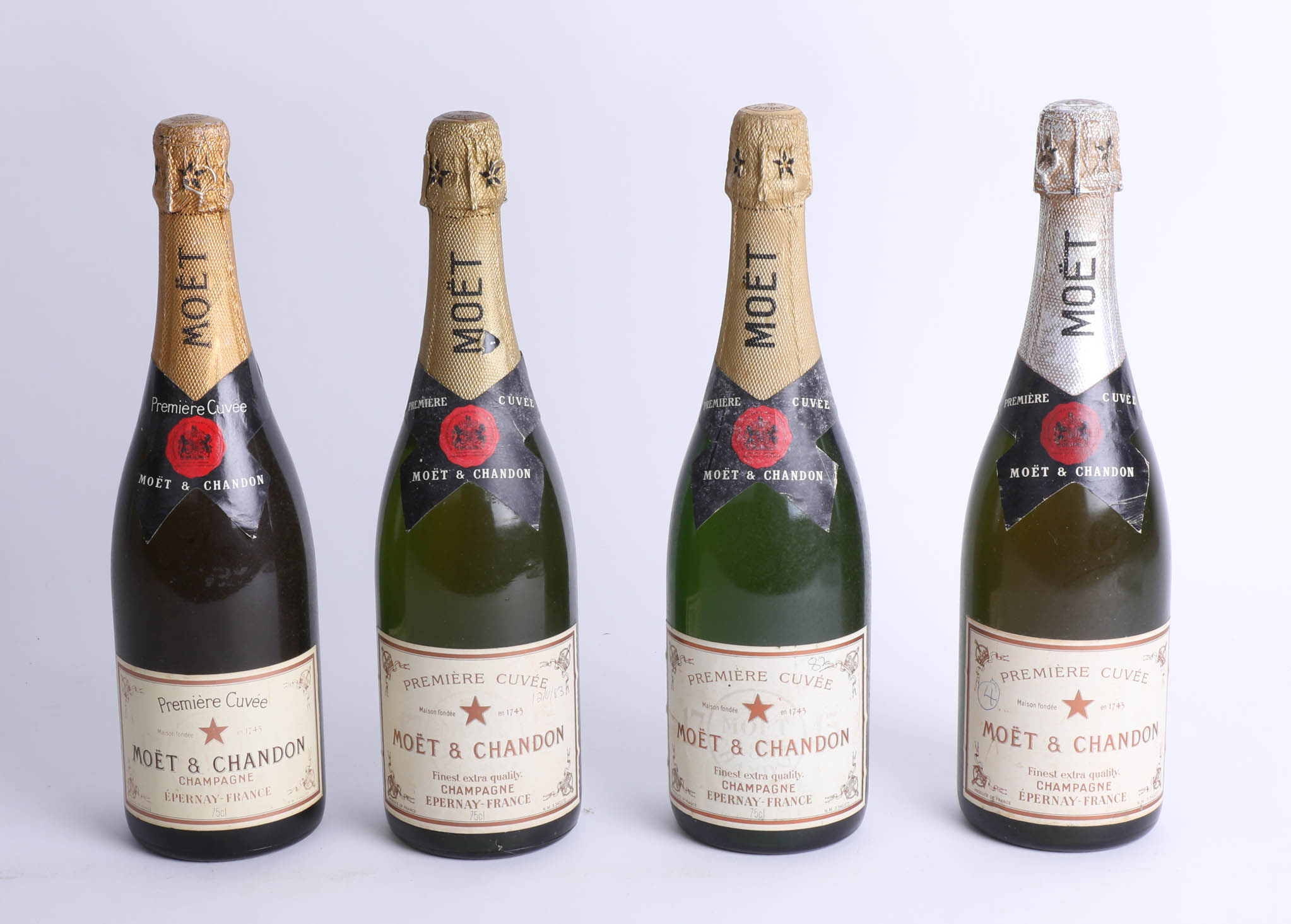 Four bottles of 1980's Moët and Chandon champagne.