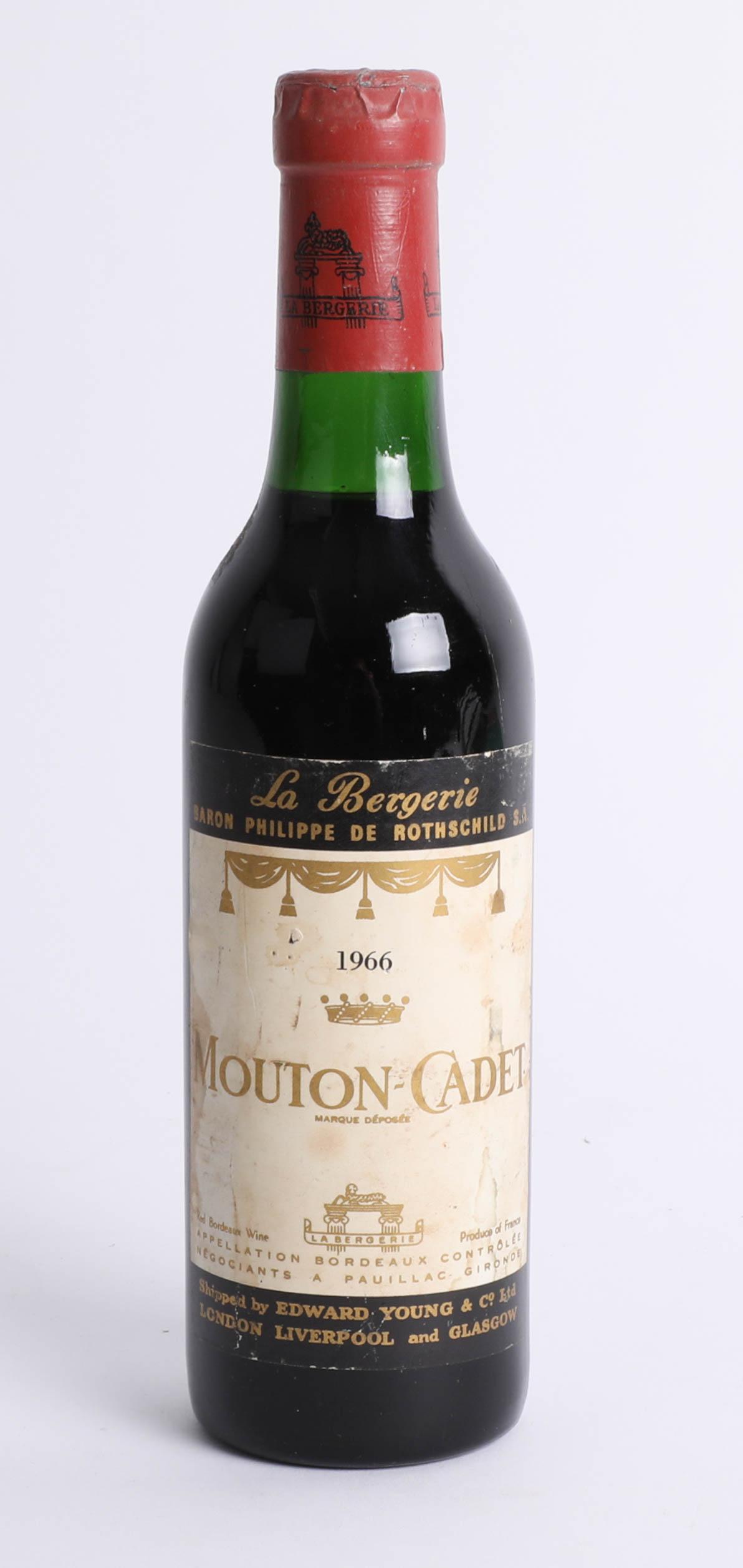 A half bottle of 1966 Mouton-Cadet red wine.