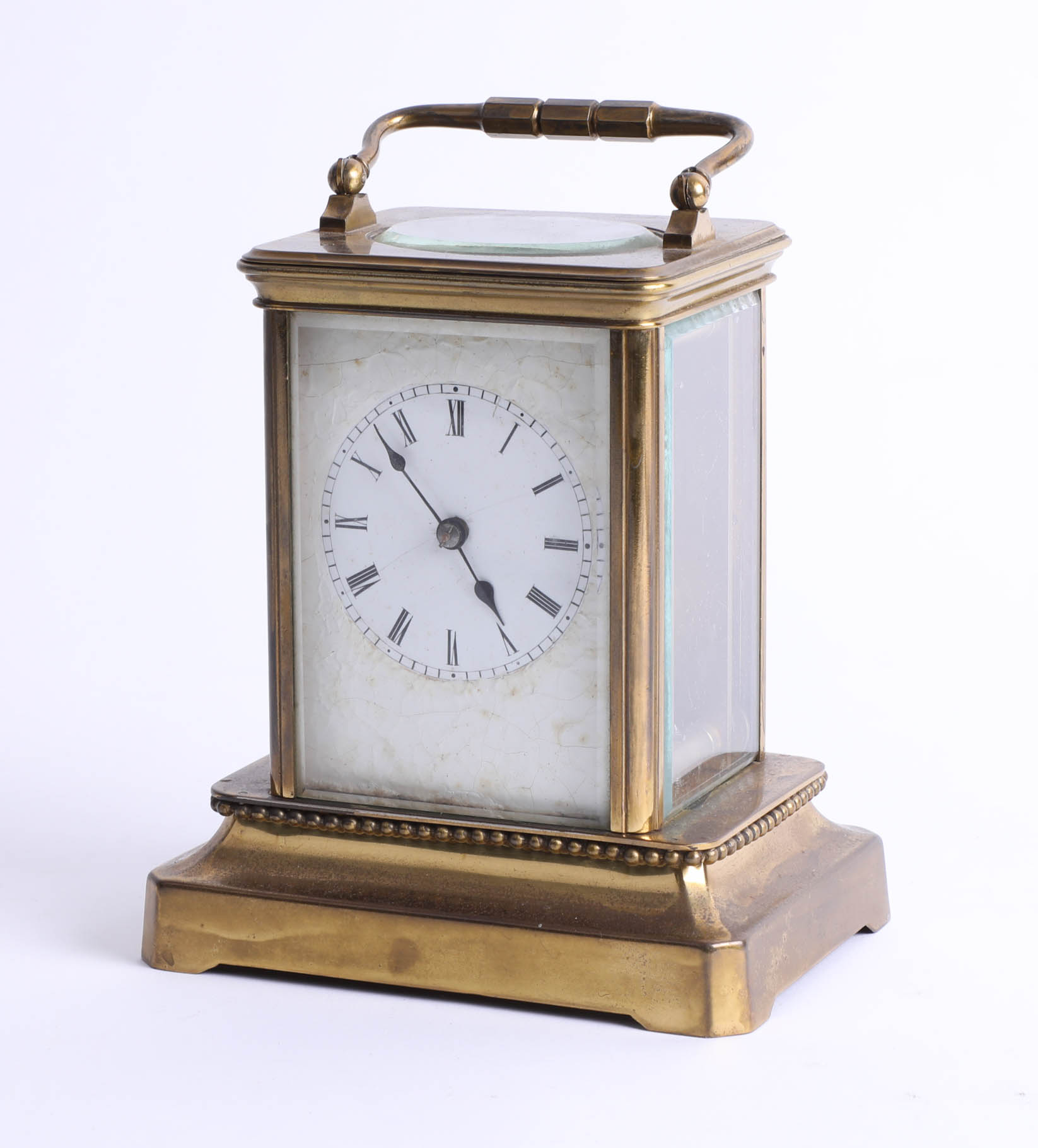 A brass carriage clock on base, maker unknown, height 15cm.