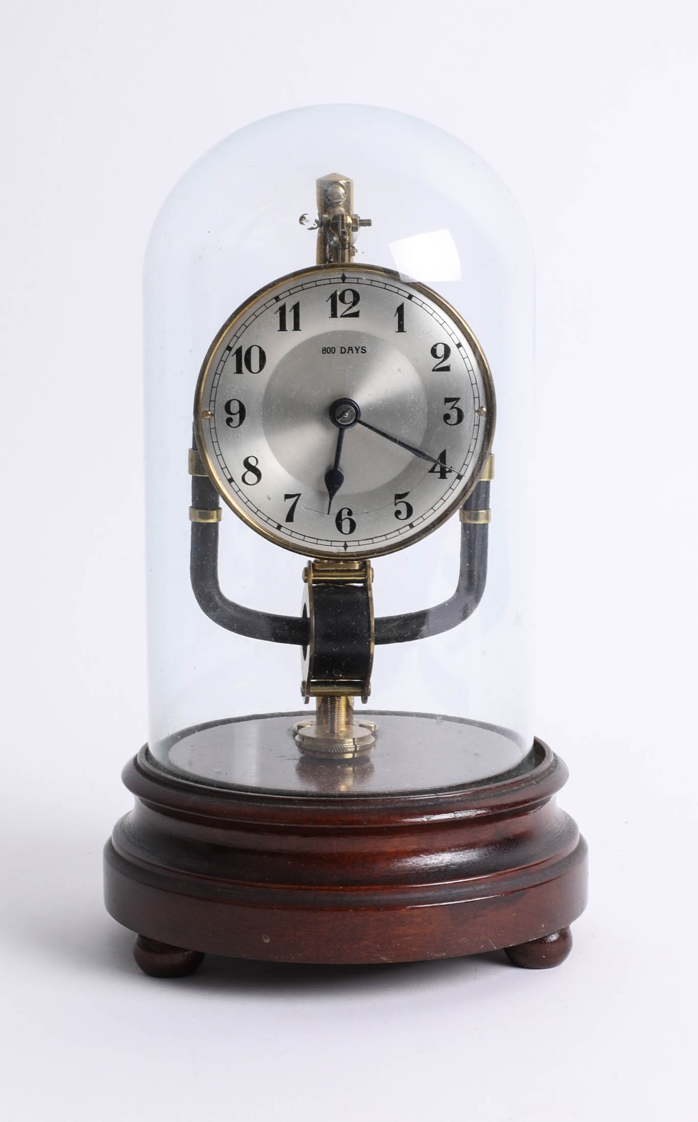 An 800 day clock (electric) under dome, height 28cm.