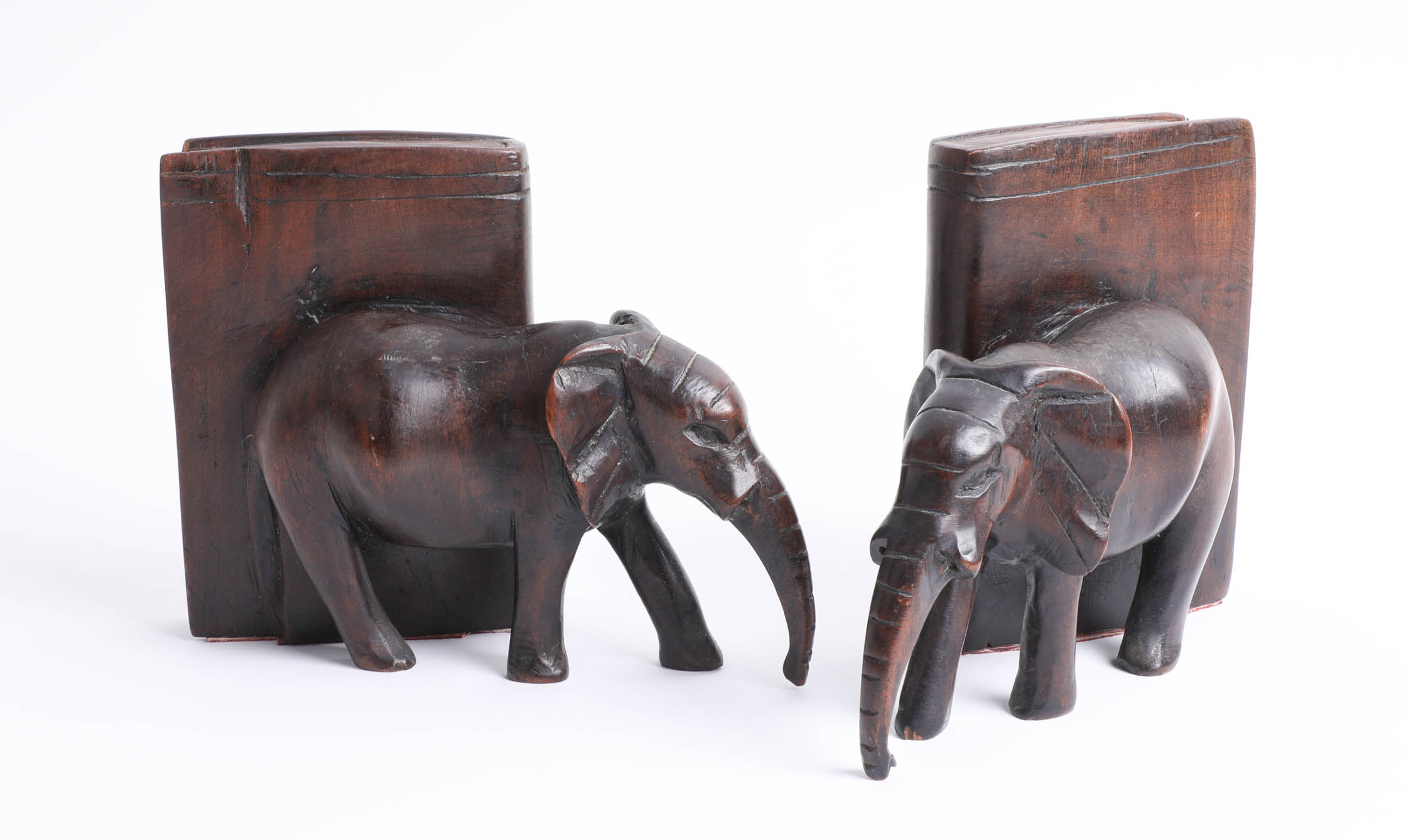 A pair of carved wooden elephant bookends.