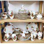 A collection of seventy four pieces of Royal Albert 'Old Country Roses'.