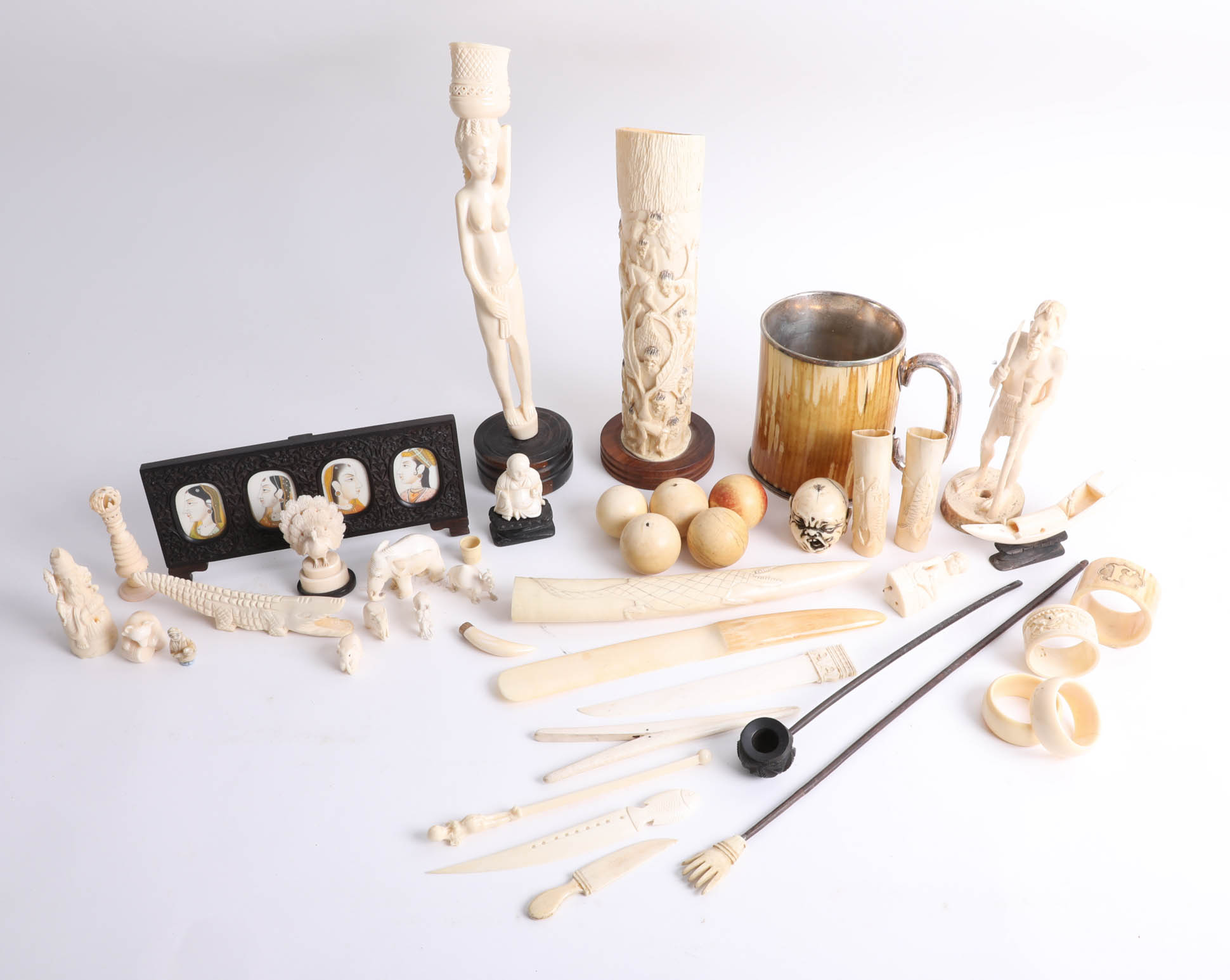 Collection of various antique carved ivory/bone objects.