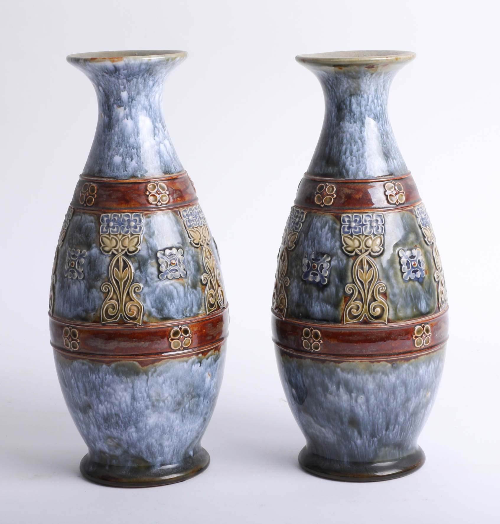 Lot 003 - A pair of Doulton art pottery vases, height 28cm.