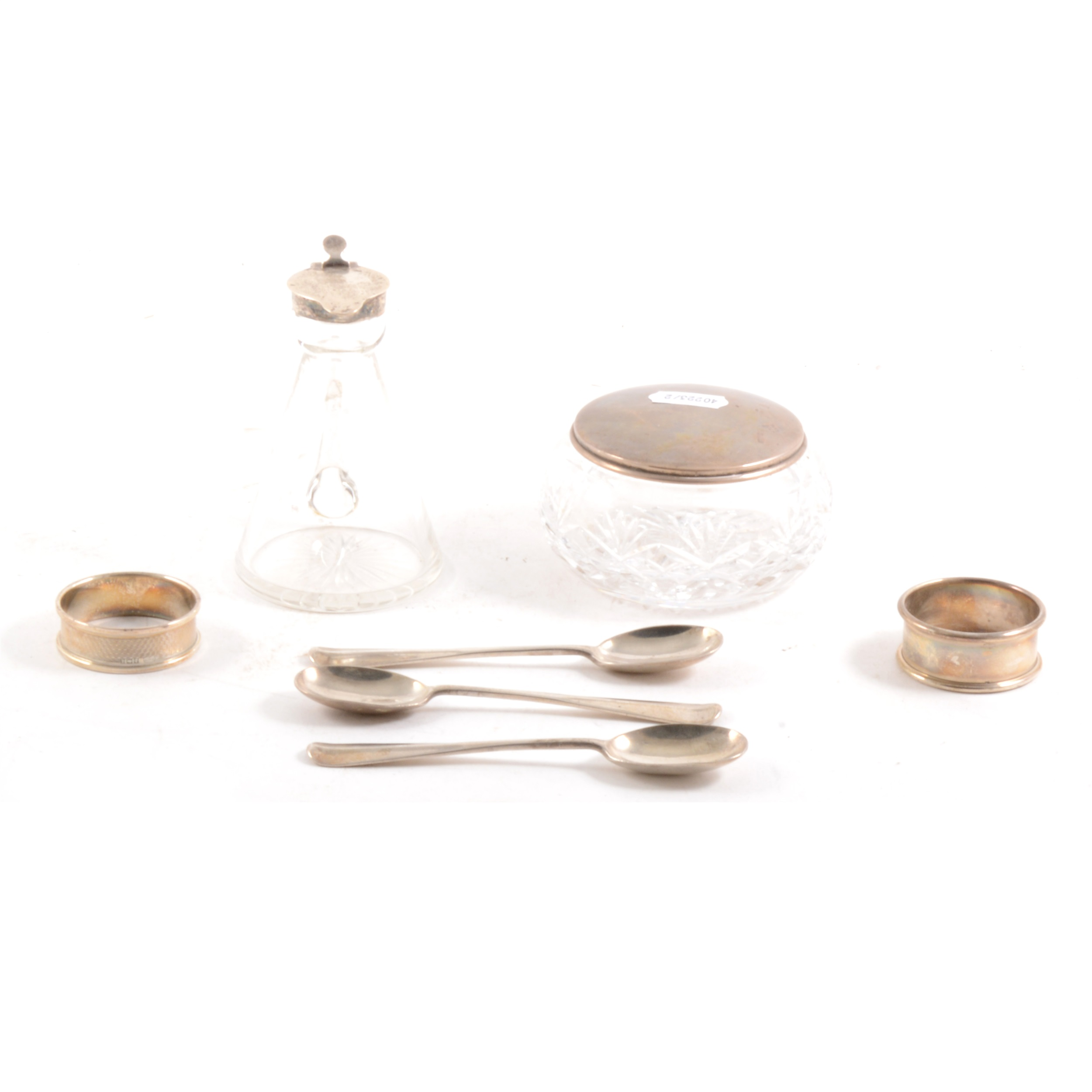 A silver mounted whisky noggin and other small silver items