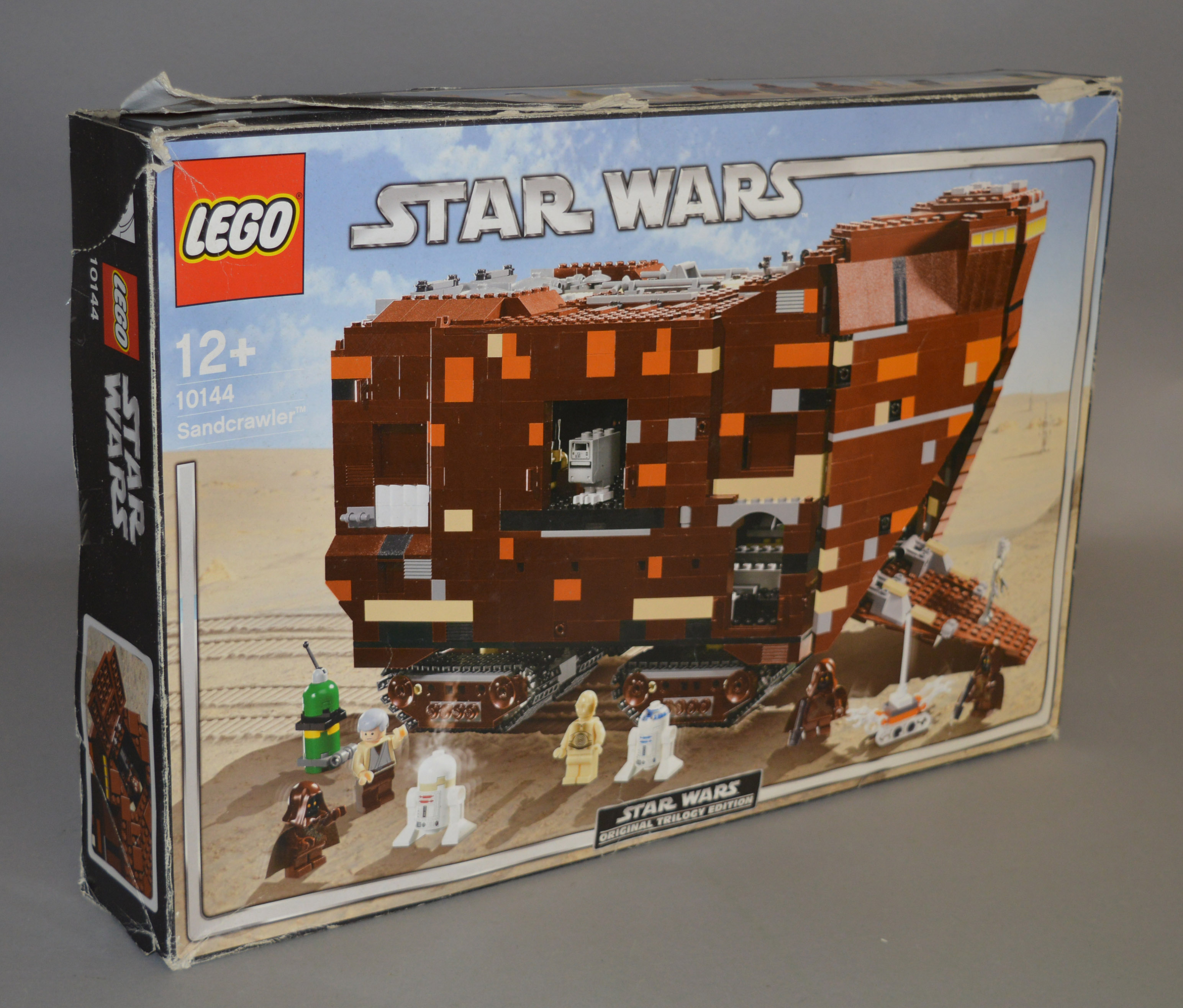 Lot 46 - Lego Star Wars 10144 'Sandcrawler', in generally F box, with crushing, tears and creasing.