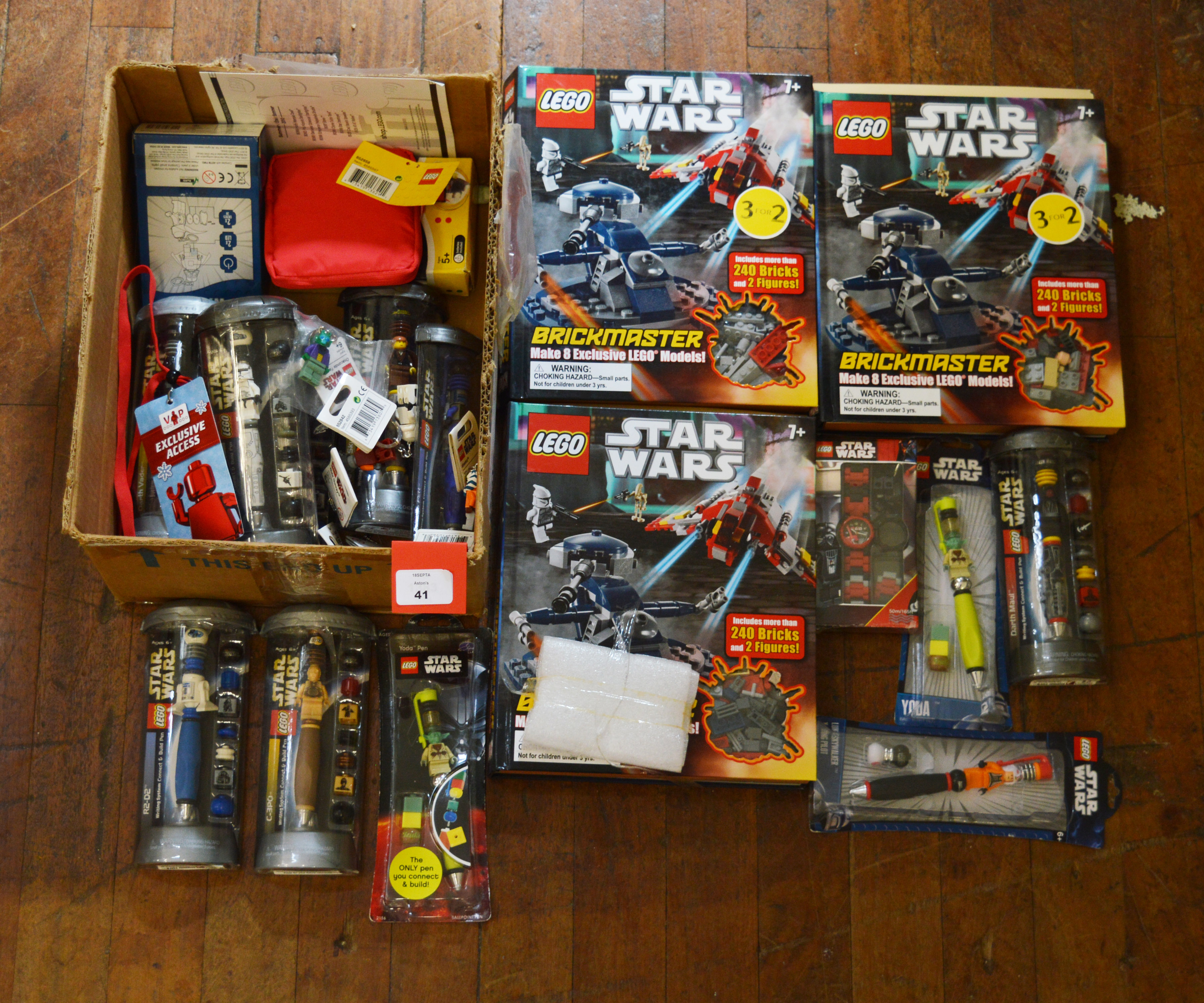 Lot 41 - Quantity of Lego Star Wars merchandise, including pens, keyrings, etc. Mostly VG.