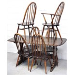 An Ercol dining table and six matching chairs (5+1), length 153cm.