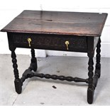 A late 17th early 18th century oak hall table,