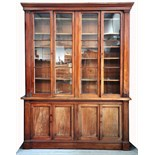A large 19th century mahogany four door bookcase with glazed upper section,