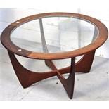 A retro circular G Plan glass topped coffee table, width 85cm.