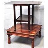 A mahogany tea trolley on castors and a modern coffee table (2).