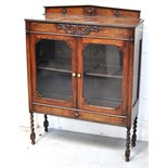 An Early 20th century bookcase with glazed doors,