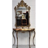 A metal gilded hall table with onyx top in the French style on cabriole legs with masque head