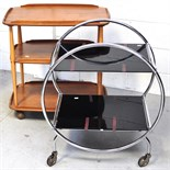 A retro light oak Ercol three tier trolley and another retro chromed example (2).