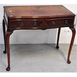 A reproduction walnut serpentine front hall table with two drawers on cabriole legs,