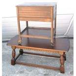 An oak occasional table and an oak sewing table on castors (2).