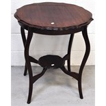 An early 20th century shaped side table on cabriole legs, with lower smaller shaped shelf,