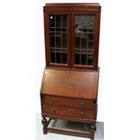 A 20th century oak bureau bookcase of small proportions, height 185cm.