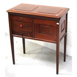 A late 19th century mahogany sewing cabinet/table on square sectioned tapering legs,