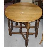 A 20th century oak gateleg table of small proportions, width 82cm.