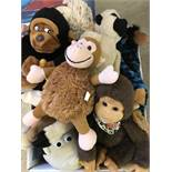 A box of assorted soft toy monkeys.