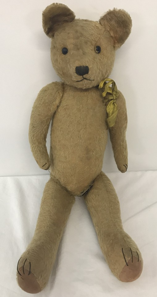 Lot 136 - A 1930's straw filled, blonde haired, jointed Teddy bear possibly Pintel.