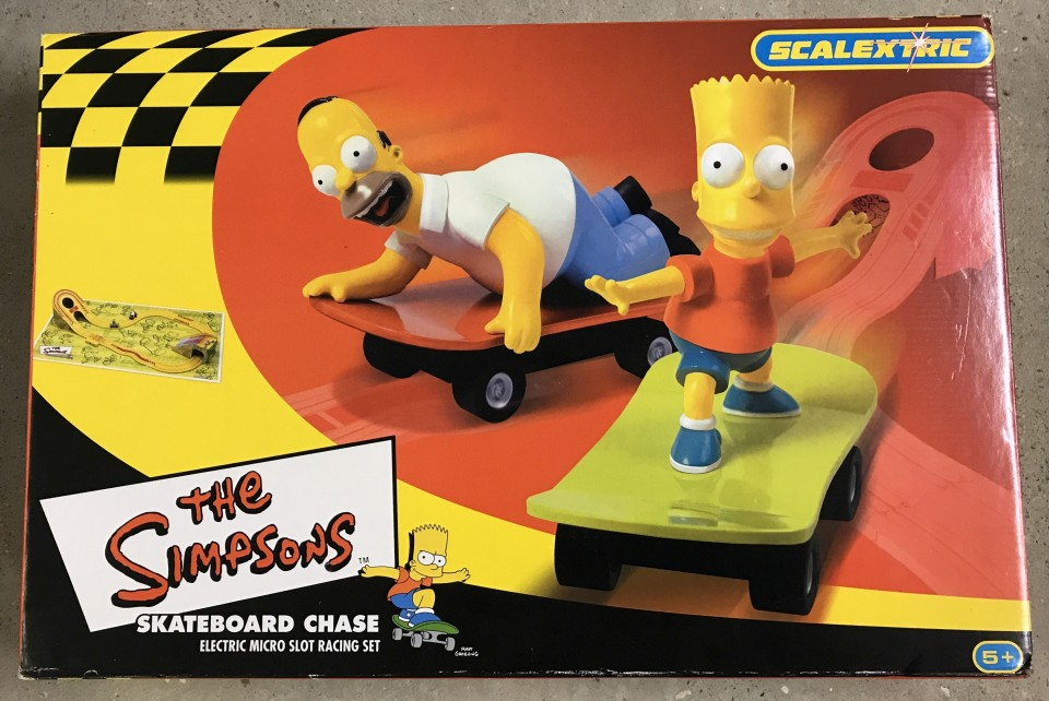 Lot 6 - Scalextric The Simpsons Skateboard Chase electric micro slot racing game.