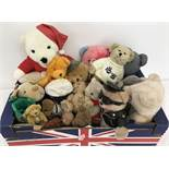 A box of assorted soft teddy bears.