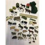 A box of vintage lead farm animals and accessories.