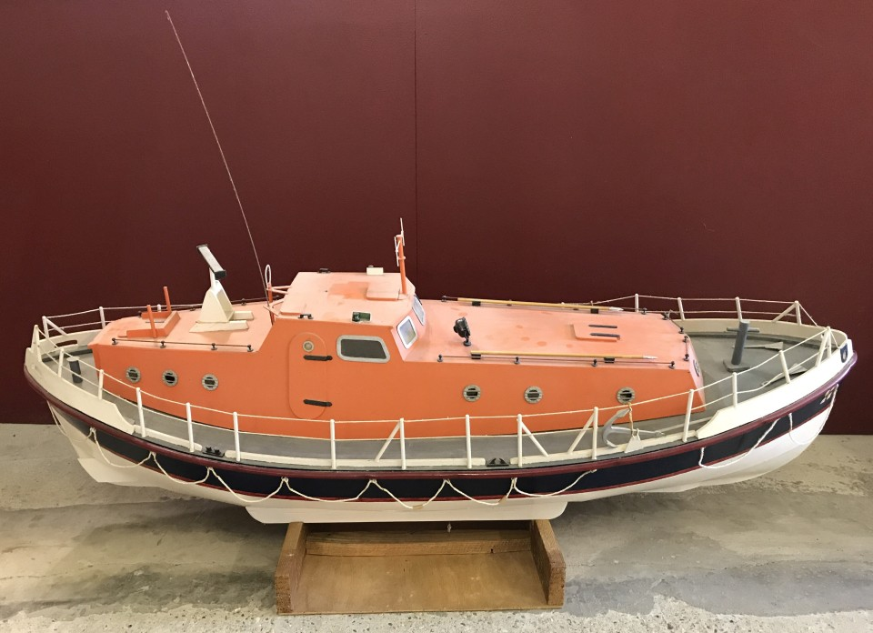 Lot 60 - A very large wooden scratch built RNLI Lifeboat on wooden stand.