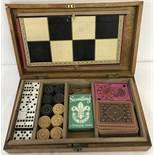 An vintage wooden cased games compendium.
