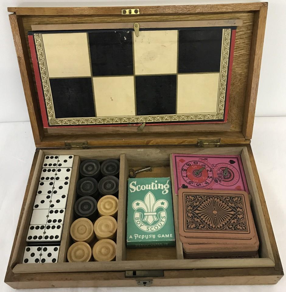 Lot 46 - An vintage wooden cased games compendium.