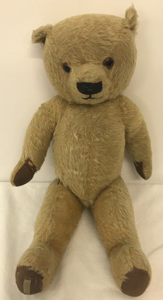 Lot 137 - A 1950's Chad Valley jointed Teddy Bear with blond hair, glass eyes & padded paws.